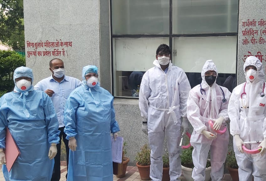 Doctors using protective equipment provided by EIM