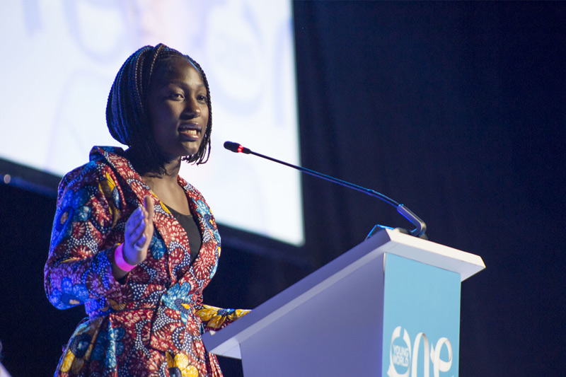 Kumba Musa talking at an OYW summit plenary