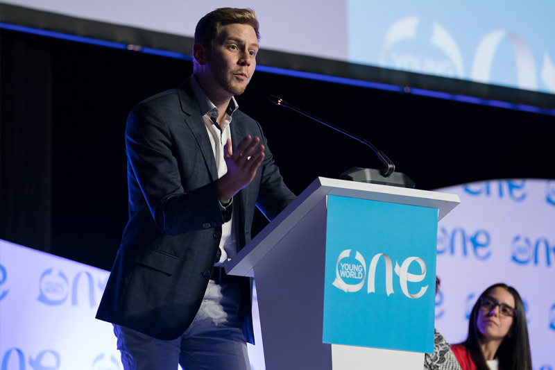 Marek Kubik talking at an OYW summit plenary
